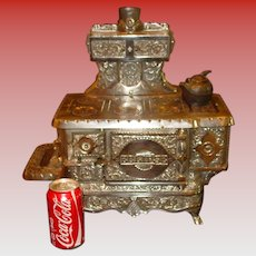 antique Nickel cast iron toy cook stove J&E Stevens