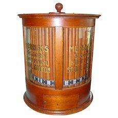 Oak Merricks cylinder style rotating spool thread cabinet