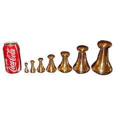 7 brass scale weights-7-4-2-1 pds & 8-4-2 oz AVERY