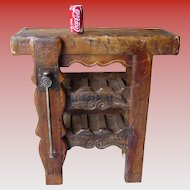 Early antique French wood worker's bench adapted as wine holder rack