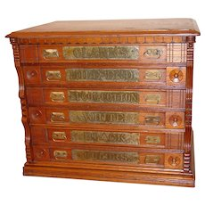 6 drawer oak Clark's spool thread cabinet with embossed pulls