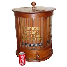 Neat round cylinder Merrick's spool thread cabinet
