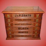 Neat J & P Coats oak spool thread cabinet