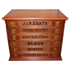 Neat J & P Coats oak spool thread cabinet