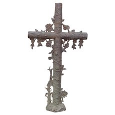 Large antique cast iron cross organic motif 43 inches tall.