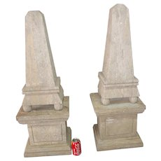 Matched pair antique classical carved stone obelisks