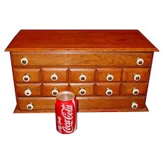 Neat 12 drawer antique oak counter top cabinet or case