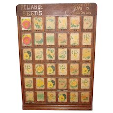 Great antique oak Sioux City Seed cabinet w flower packs