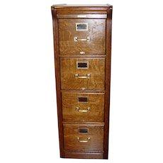Exceptional 4 drawer quartered oak antique file cabinet