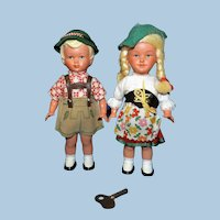 Pair of post WWII Key Wind Dancing dolls