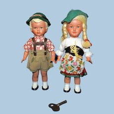 Pair of post WWII Key Wind Dancing dolls