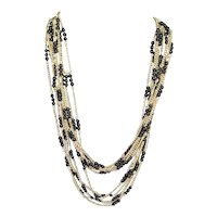 Black and Gold Tone Opera Length 5 Strand Necklace