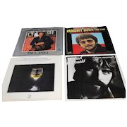 Four 45 RPM Vinyl Records with Picture Sleeves