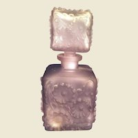 Lavender frosted Holmspray perfume bottle with raised flowers