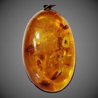 Large Cabochon Amber pendant silver bezel