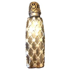 Small metal overlay perfume scent bottle