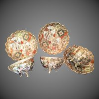 4 Oriental China ornate footed Cups and Saucers heavy gold