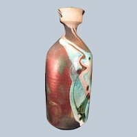 Art pottery vase iridescent and rough Signed S. Young 1979
