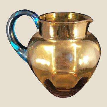 Vintage Honey Amber glass pitcher with Aqua Handle