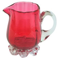 A Pretty Little Antique Cranberry Footed Creamer