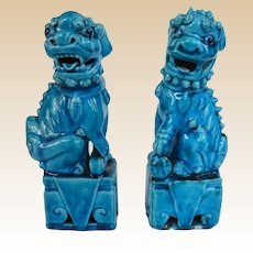 A Pair of Antique Chinese Peacock Blue Foo Dogs