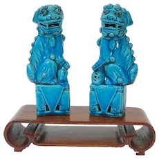 A Small Pair of Antique Chinese Peacock Blue Foo Dogs on Stand