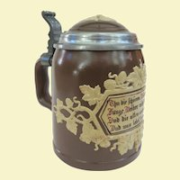 An Antique Mettlach German Beer Stein Hops and Vines With Saying 1180