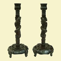 A Rare Pair of Japanese Meiji Rosewood Dragon Candlesticks