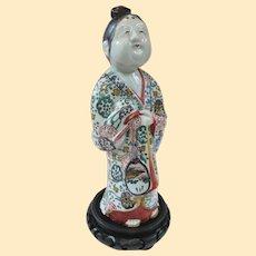 A Delightful Edo Period Porcelain Okame Otafuku Figure