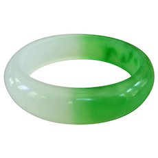 A Vintage Two Tone Jade Bangle, 59.4mm