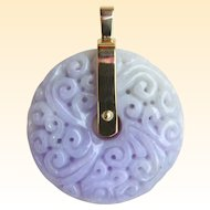 A Stunning Natural Lavender and Celedon Jade Carved Disk Pendant