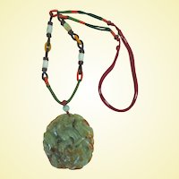 A Magnificent Jade Dragon Pendant Necklace