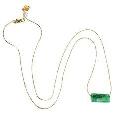 A Beautiful Jade Barrel and 14 Karat Gold Necklace