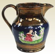 A Rare Lustreware Creamer with Raised Images