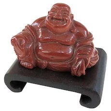 An Older Goldstone Hotei Buddha on Carved Stand