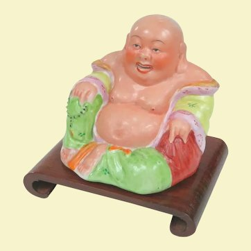 A Vintage Ceramic Hotei Buddha On Wooden Stand