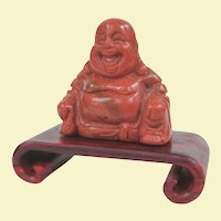 A Tiny Goldstone Hotei Buddha on Wooden Stand