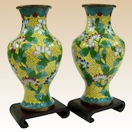 A Bright and Colorful Pair of Antique Chinese Cloisonné Vases on Stands