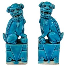 An Old Pair Of Miniature Peacock Blue Porcelain Foo Dogs Foo Lions