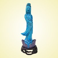 A Peacock Blue Porcelain Chinese Kwan Yin Figure on Stand