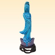 A Peacock Blue Porcelain Chinese Kwanyin Figure on Stand
