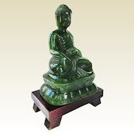 An Exceptional Jade Gautama Buddha on Wooden Stand