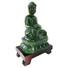 An Exceptional Jade Gautama Buddha on Wooden Stand