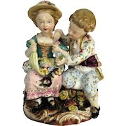 A Meissen Group, Boy and Girl Examining Flowers, C1820s
