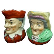 A Rare Pair of Early Staffordshire Punch and Judy Toby Mugs C1850