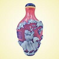 A Masterwork Carved Peking Glass Snuff Bottle