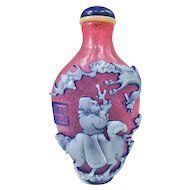 A Masterwork Carved Peking Glass Snuff Bottle
