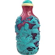 A Masterwork Peking Overlay Carved Glass Chinese Snuff Bottle