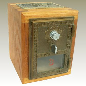 A Vintage Bank Made From Original Old Post Office Box Door