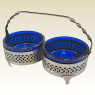 An Elegant Reticulated Silver Plate Holder With Cobalt Glass Nut Dishes